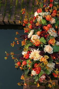 What a beautiful arrangement of fall colors, These reminde me of my Friend Sister V, and my cousin Myrle, such talent, Try you Gifts.... <>