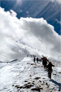 Skiers hike to Kachina Peak. Taos.