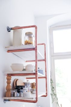 Every time I post a picture of our kitchen the most popular part of it is our DIY copper pipe shelf. I don't know...