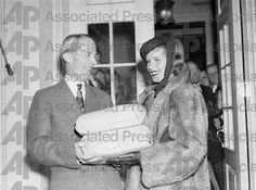 Actress Frances Farmer gives packages of petitions to White House Secretary Marvin McIntyre. Over 200,000 have protested the curtailment of federal arts projects in New York.