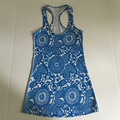 New blue & White floral Lululemon cool racerback New without tags. Too small for me. Willing to trade for a size 4 tank. lululemon athletica Tops Tank Tops