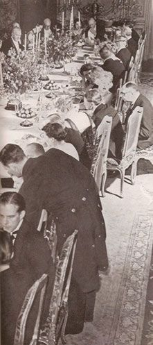 Grace Vanderbilt (upper right turned in her chair to talk with the man on the right) at a small dinner for 40 in her 640 Fifth Avenue dining room in the early 1940s. Mrs. V never drank but she loved candy and desserts (her favorite: raspberry and vanilla ices smothered in mint flavored chocolate sauce and surrounded by candies).