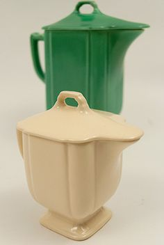 Circa 1937-1941: This extremely rare Riviera pottery lidded syrup by Homer Laughlin is one of the most advanced pieces to add to your vintage Riviera, Fiesta, and Harlequin pottery line. Hardly ever seen, this example in the original ivory Century glaze is in perfect condition without damage or use.