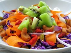 Rainbow Salad  Inspired by Homemakers.com  Serves 2      Ingredients  4 kiwi fruits, chopped  4 tbsp red onion, chopped  1 cup red cabbage, thinly sliced  1 large carrot, peeled  2 tbsp raisins  2 tbsp goji berries, soaked  4 tbsp roasted cashew nuts    Dressing  Juice of 3 limes  3 tbsp light olive oil  2 tbsp honey Light Olive Oil, Rainbow Salad, Roasted Cashews, Red Cabbage, 2 Ingredients, Quick Recipes, Fruit Salad, Main Dishes, Tasty