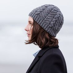 """This is a printed pattern that requires shipping. A quick knit in chunky Quarry, Burnaby's cable and seed stitch texture is reminiscent of the patterning on a sea urchin shell. SIZING: 20"""" circumferen"""