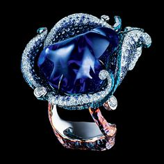 1 baroque tanzanite 43,05 ct 329 diamonds 2,19 ct 581 sapphires 4,98 ct