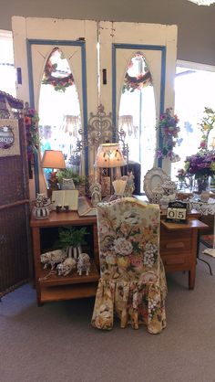 Shabby chic display inside our store using our original doors from the 1920s!