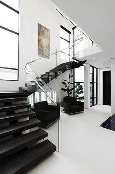 Dark staircase/white room