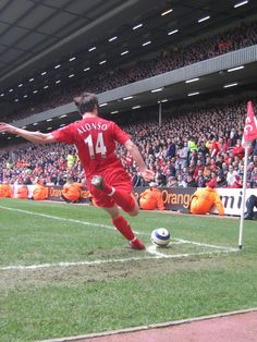 @Liverpool FC legend Xabi Alonso takes a corner in front of the Anfield Road End #LFC