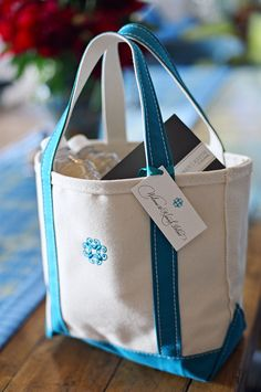 welcome bag ideas for out of town guests- I used a navy and cream one with anchors for a wedding in Newport, RI