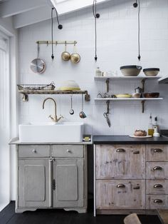 Open shelves—made using floorboards—are supported by bronze hardware of Lewis's design. Photography byRory GardinerfromKitchen of the Week: A Family Gathering Spot in a London Victorian.
