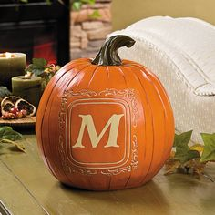 """Monogrammed Pumpkin - OrientalTrading.com  Monogrammed Pumpkin. You'll enjoy displaying this monogrammed pumpkin in your home year after year. The realistic design has a hand-carved look that complements your décor from Halloween through Thanksgiving. Personalize with 1 character. Resin. 11""""H. © OTC $20.00 NOW $17.98 Each (3/28)"""