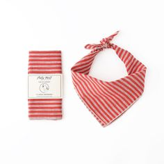 Handmade in Brooklyn, NY, this traditional square bandana is cut from red and cream striped linen and sewn with cream stitching. It is the perfect accessory for any time of the year. Place a wet kerch