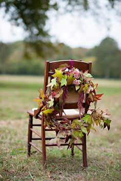 Fall leaf wreaths as chair decor. Julie Anne, Wedding Photographer  Read more - http://www.stylemepretty.com/georgia-weddings/2013/11/06/whimsical-bridal-portraits-from-julie-anne-wedding-photographer/