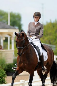 Christina Vinios rode Donna Carina 6 in the Prix St. Georges test for developing horses wearing a smart brown shadbelly, matching helmet and shiny brown boots.   Chronicle of the Horse