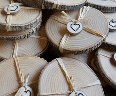 Lovely favor - coaster wrapped with raffia and finished with a tag with a heart wood burned on it.