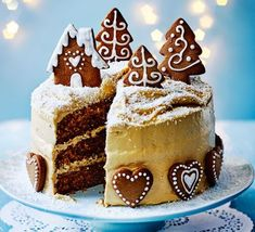 Gingerbread cake with caramel biscuit icing This sumptuous Christmas bake is covered in a decadent icing, finished with gingerbread biscuits and dusted with desiccated coconut 'snow' << plus this is the cover recipe for our November Christmas issue Xmas Food, Christmas Cooking, Christmas Desserts, Christmas Treats, Christmas Cakes, Christmas Biscuits, Mary Berry Christmas Cake, Xmas Cakes, Christmas Crack