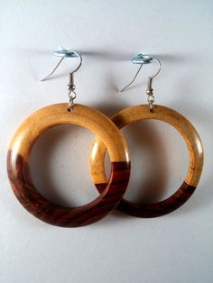 This pair of exotic wooden earrings, are sourced from reclaimed Nicaraguan cocobolo. All of our items are sourced from reclaimed pieces of Nicaraguan solid hardwoods, that are made available to us by the leftover reclaimed pieces from classical guitars. Be Unique. Stay Unique. NicArte