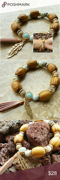 Leaf boho wood fringe Uniquely handcrafted stretch bracelet. Made w exotic wood acrylic bead accents, accented w a gold plated leaf and leather tassel. Discounts given on bundles. Salty Grace  Jewelry Bracelets