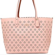 "✨COACH laser cut city tote✨ % AUTHENTIC COACH laser cut city tote.  Color is peach rose glitter (blush pink color with faint glitter flecks throughout - see close up photo).  Measures approx 14""W x 11.5""H x 5.5""D.  1 large zip pocket and 2 slip pockets inside.  Gorgeous bag!!! Coach Bags Totes"