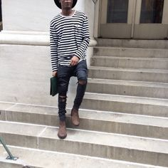 Striped tee, ripped jeans, chelseas