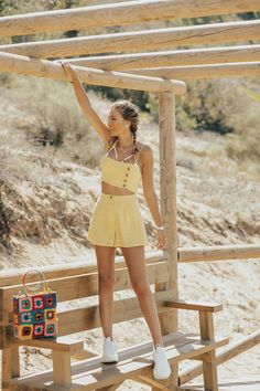 d218f9c0850 Yellow linen crop-top and high-waisted shorts+white sneakers+white floral  print bikini+gold necklace+golde earrings+colorfull crochet handbag  tote  bag.