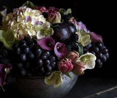 Gorgeous right?  Hydrangeas, calla lilies, hellebores, tulips, plums, grapes, and blackberries.  This purple palette is a favorite of mine.