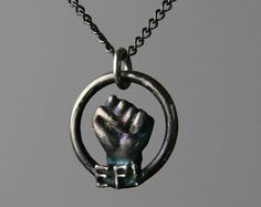 Earth First Jewelry Fist Necklace by MoonStarsJewelry on Etsy