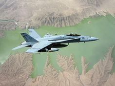 An F/A-18E Super Hornet assigned to the Rampagers of Strike Fighter Squadron 83 flies over the Kajaki Dam reservoir in Afghanistan. VFA-83 is embarked aboard the aircraft carrier USS Dwight D. Eisenhower and is deployed to the U.S. 5th Fleet area of responsibility supporting Operation Enduring Freedom. (U.S. Navy photo by Lt. Cmdr. Ben Stickney)  Navy Visual News Service  Date: 05.20.2010  Location: AF  Related Photos: dvidshub.net/r/yga48e