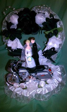 Cake topper custom made with a purple Harley Davidson Motorcycle a Traditional Bride groom with matching flowers. Description from pinterest.com. I searched for this on bing.com/images