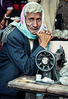 Portrait of a tailor sitting at his sewing table. Jodhpur, Rajasthan, India by Яachel caЯbonell (in Barcelona), via Flickr