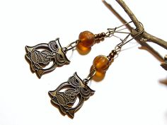 Bronze Owl Earrings With Amber Beads by MURPHYSTREASURES2 on Etsy https://www.etsy.com/listing/196540251/bronze-owl-earrings-with-amber-beads