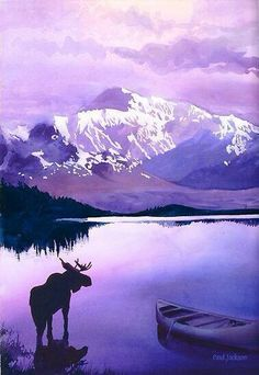 Alaska with moose by lake with snow covered mountain in the distance.