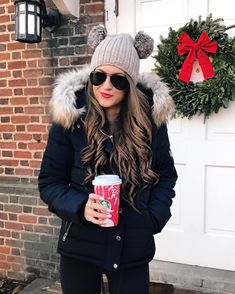 Black puffer jacket, Ray Bans, and a Starbucks red cup