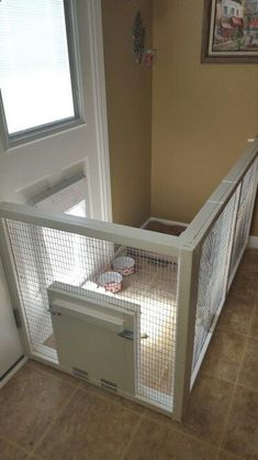 Dog Door - Dog gate with doggie door. Keeps the house clean & gives the dog access to inside/outside while we're gone. #gate #doghousekennel