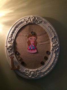 Masterpiece Framed Showcase. Antique frame painted & distressed with a burlap covered cork board to pin up our little artist's newest creations. Complete with our handmade bottle cap thumbtacks!)