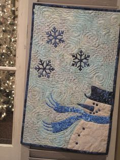 Snow Snuggly at hollyhillquiltshoppe.com - Quilt trio by laundry basket quilt