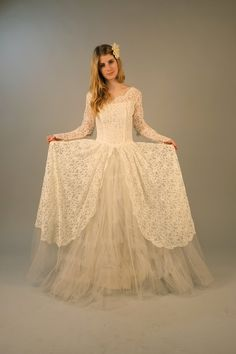Vintage 1950s lace wedding dress with full skirt. $380.00, via Etsy.
