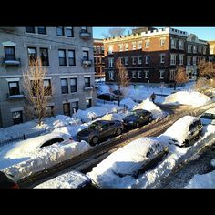 the street viewed from my bedroom window, one day after the blizzard Nemo hit Boston. some cars have been shoveled off, some still have been left buried under snow, driveway & walkway have been plowed, all businesses remained closed. ⛄. (picture taken on 2013.02.10)