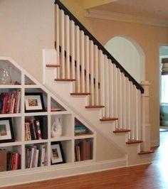 Built In Bookcase Under Stairs: Built in Shelves under Staircase Interior Design Magazine, Shelves Under Stairs, Staircase Bookshelf, Stair Shelves, Staircase Remodel, Stair Storage, Built In Bookcase, Bookshelves, Bookshelf Styling, Storage Shelves
