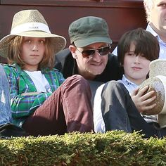 "Bono with sons Elijah Bob Patricius Guggi Q and John Abraham. Poor Elijah - Bob was after Bono's dad and Guggi is after a friend, but come on now! And, throwing ""Q"" in at the end is just silly."