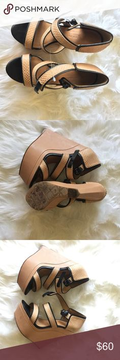 L.A.M.B strapped wedges Pre loved black & brown wedges. In great condition. L.A.M.B. Shoes Wedges