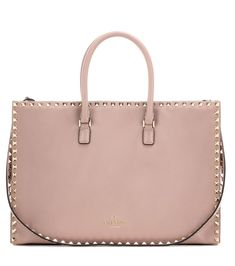 Valentino - Valentino Garavani Rockstud Flat Big Working leather tote bag - Crafted from high-quality, smooth blush-hued leather, Valentino's Rockstud Flat Big Working tote is the perfect silhouette for the carry-everything crew. A roomy interior with internal zipped pouch has all the space we want for office-to-date days. Lined with the designer's distinctive Rockstuds, this is a classic piece that will add an instant dose of tough-luxe glamour to everyday edits. seen @ www.mytheresa.com