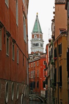Campanieli peeking out from behind the buildings.  #Venice, Italy