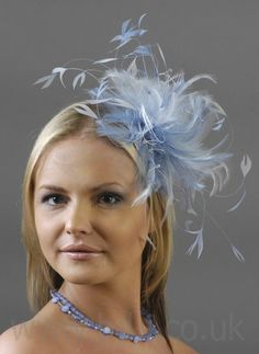 this is a bit large and blue, but loving the feather fascinator!