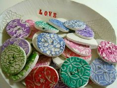 These cute buttons are handmade by Melissa from yourhandmadehome.co.uk.  I wonder if she also made the ceramic bowl they're in??