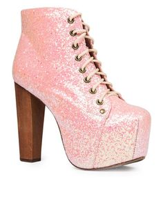 This is pretty much the best thing to ever happen to shoes. Own thistime honored tradition,Lita Ankle Boots Light Pink Glitterby Jeffrey Campbell. The heel height measures 13cm and will have you towering over everyone. You call yourself a shoe lover? Well, thengrace your wardrobe with some serious style. Pair it with jeans and leggings in winter, or look extra glam with a mini skirt in summer.