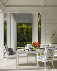 The table and chairs outside the pool pavilion are custom made by McKinnon and Harris, with cushions in a Perennials acrylic.  Hamptons Living Room Design - Haynes Roberts Bridgehampton Home - ELLE DECOR