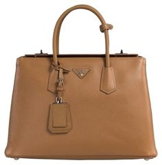The Prada Caramel Leather Tote is a top 10 member favorite on Tradesy. 5a6a9d675d