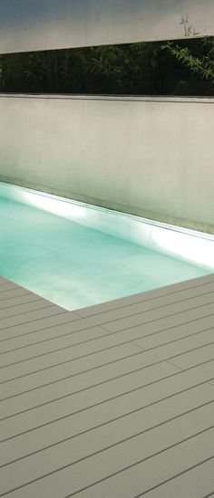 Skema's line of outdoor decking offers beautiful durable surfaces that will last a lifetime. Shown here in Cemento.